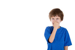 Adorable kid pinching his nose Stock Images