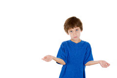 Adorable kid putting hands out in a gesture that says so what, who cares Stock Photo