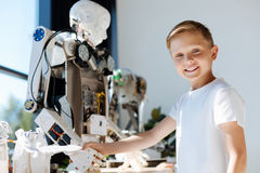 Adorable kid shaking hands with human robot stock photos