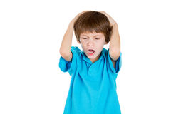 Adorable kid stressed with headache, hands on head Stock Photography