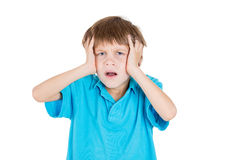 Adorable kid stressed with headache, hands on head Stock Image