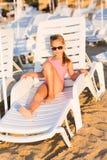 Adorable kid sunbathing on a beach Royalty Free Stock Image