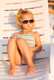 Adorable kid sunbathing on a beach Stock Images