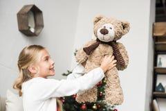 Adorable kid with teddy bear Stock Photo
