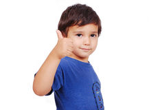 Adorable kid with thumb up and cute face Royalty Free Stock Photography