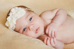Adorable kid woke up in the crib. Royalty Free Stock Photography
