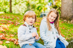 Adorable kids in autumn park Royalty Free Stock Images