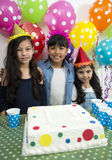 Adorable kids having fun at birthday party. Group of adorable kids having fun at birthday party Royalty Free Stock Images