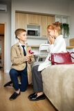 Adorable kids in love, boy make proposal to redhead girl