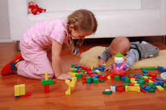 Adorable kids playing with blocks royalty free stock image