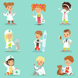 Adorable kids playing doctor set. Smiling little boys and girls dressed   Stock Image