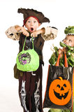 Adorable kids playing trick or treat Stock Photo