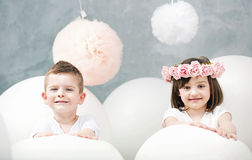 Adorable kids playing white balloons Stock Photography