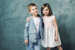 Adorable kids posing and hugging Royalty Free Stock Photos