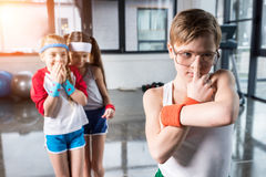 Adorable kids in sportswear fooling around at fitness studio. Children sport concept royalty free stock image