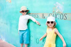 Adorable kids in Turks and Caicos. Adorable kids against colorful wall in Turks and Caicos Royalty Free Stock Photos
