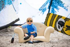 Adorable kiteboarder boy in the chair Stock Photo
