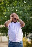Adorable latin child in the garden royalty free stock photo