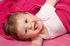 An adorable, laughing baby Royalty Free Stock Photography