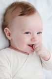 Adorable laughing baby boy. Over white Stock Photo