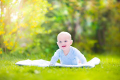 Adorable laughing baby in the garden Royalty Free Stock Images