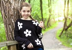 Adorable laughing child in forest Stock Photos