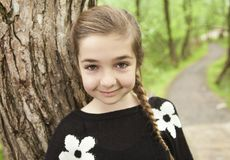 Adorable laughing child in forest Royalty Free Stock Photography