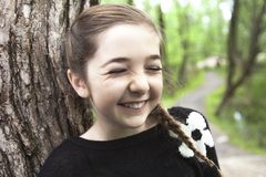 Adorable laughing child in forest Royalty Free Stock Images
