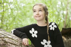 Adorable laughing child in forest Stock Image
