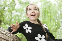 Adorable laughing child in forest Royalty Free Stock Photo