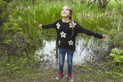 Adorable laughing child in forest Stock Photo