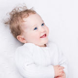 Adorable laughing little baby in warm knitted jacket Royalty Free Stock Image