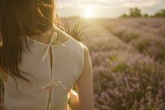 Adorable lavender field mood. Unrecognizable portrait of young tender woman. Sunset soft light. Back view. Romantic mood stock photos