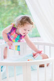 Adorable litlte toddler girl with newborn brother Stock Photos