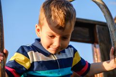 Free Adorable Little 3-4 Year Old Toddler Boy Having Fun On Playground, Child Royalty Free Stock Image - 147748336