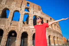 Adorable little active girl with map in front of Colosseum in Rome, Italy. Kid spending childhood in Europe Stock Photo