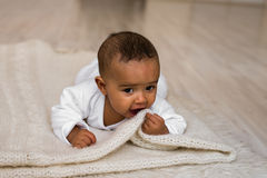 Adorable little african american baby boy looking - Black people Stock Photos