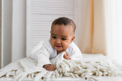 Adorable little african american baby boy looking - Black people Stock Image