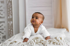 Adorable little african american baby boy looking - Black people Royalty Free Stock Image