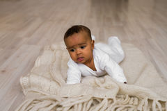 Adorable little african american baby boy looking - Black people Stock Images