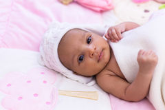 Adorable little african american baby girl looking - Black peopl Stock Photos