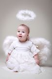 Adorable little angelic girl. With wings and nimbus stock photos