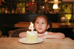 Adorable little Asian child girl with happy birthday cake 4 years old.  royalty free stock photo