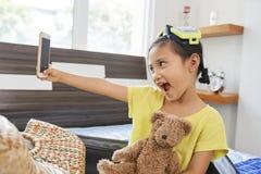 Little girl taking selfie stock images
