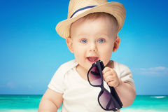 Adorable little baby boy posing. Cute baby boy posing in summer hat. Adorable little child in studio royalty free stock photography