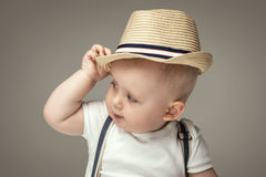Adorable little baby boy posing. Cute baby boy posing in summer hat. Adorable little child in studio royalty free stock images
