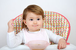 Adorable little baby eating Stock Photos