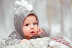 Adorable little baby in a funny bodysuit Royalty Free Stock Photos