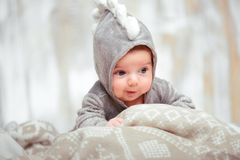 Adorable little baby in a funny bodysuit Royalty Free Stock Photography