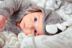 Adorable little baby in a funny bodysuit Royalty Free Stock Images